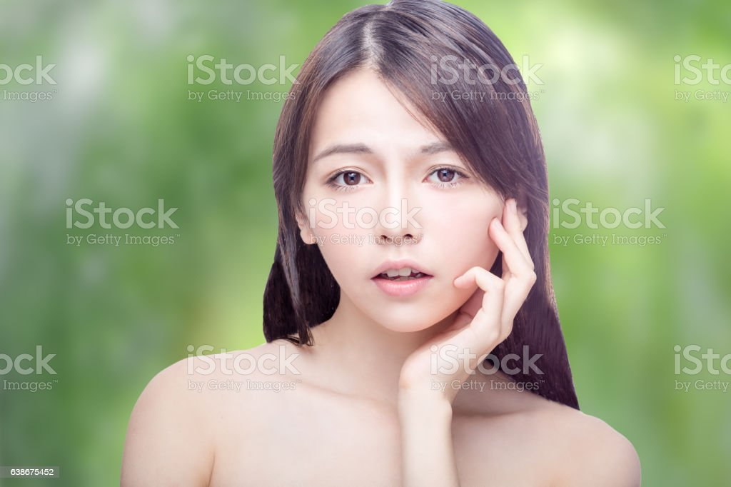 Asian beauty portrait on blurred greenery stock photo