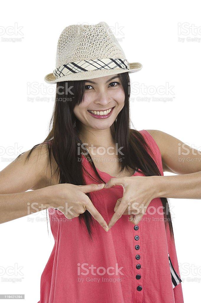 asian beauty shaping a heart stock photo