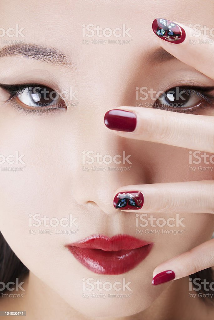 Asian beauty with professional makeup and nail art stock photo