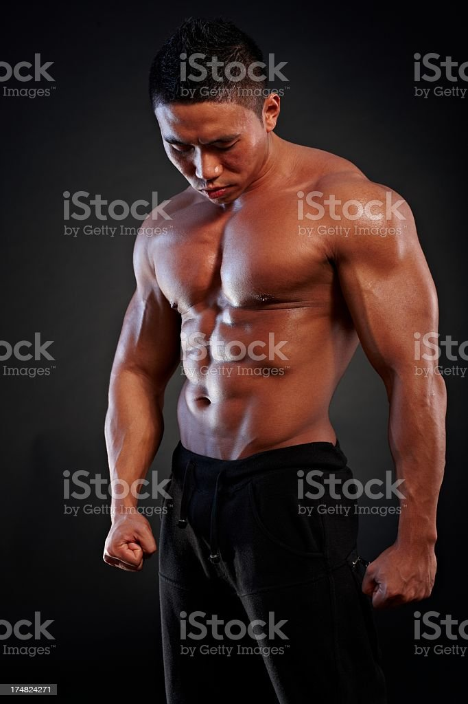 Asian body builder posing royalty-free stock photo