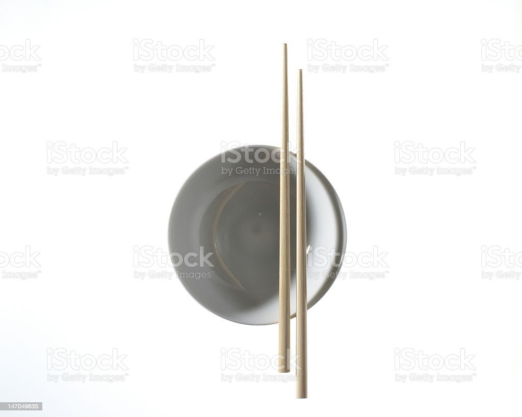 asian bowl with a pair of chopsticks on white background royalty-free stock photo