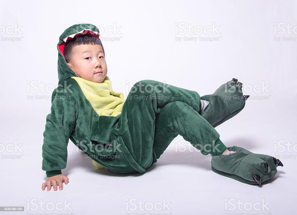 Asian boy acting dinosaur stock photo