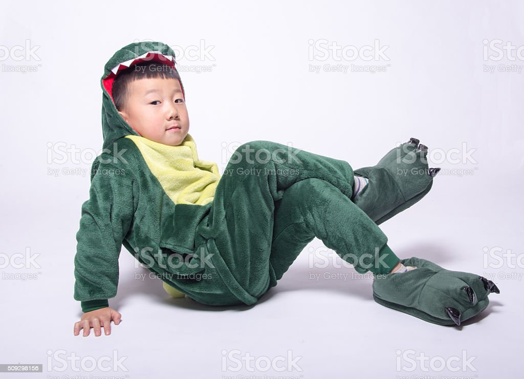 Asian boy acting dinosaur stock photo