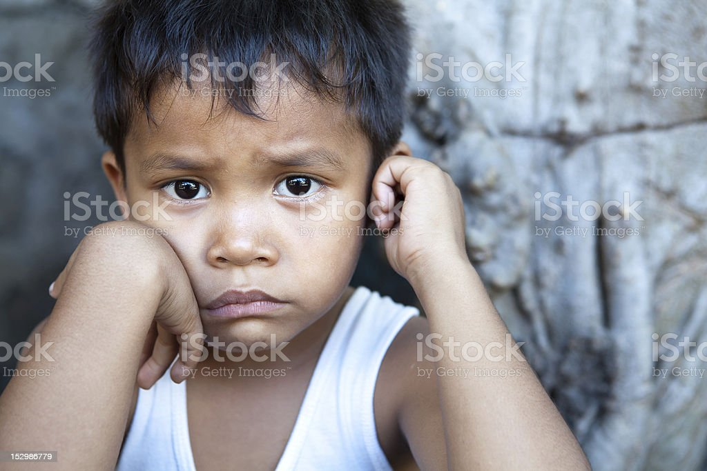 Asian boy against wall portrait stock photo