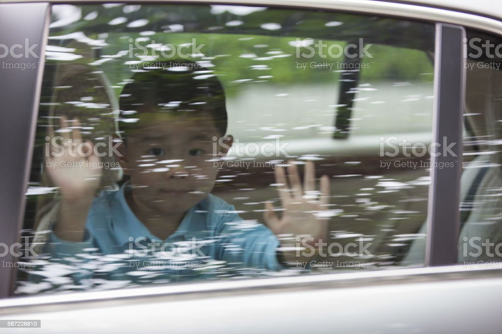 Asian boy clap car window stock photo