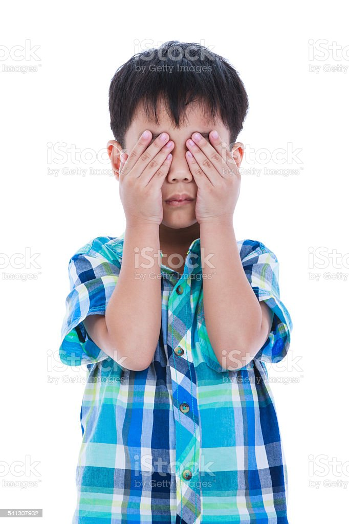 Asian boy covering his eye. Isolated on white background. stock photo
