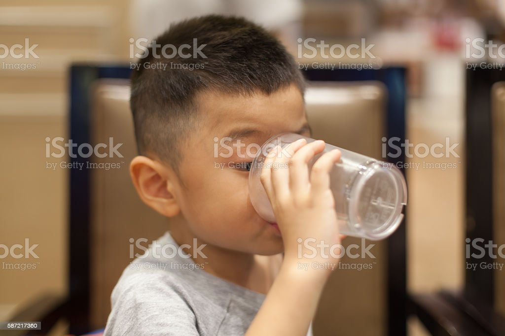 Asian boy drink water stock photo