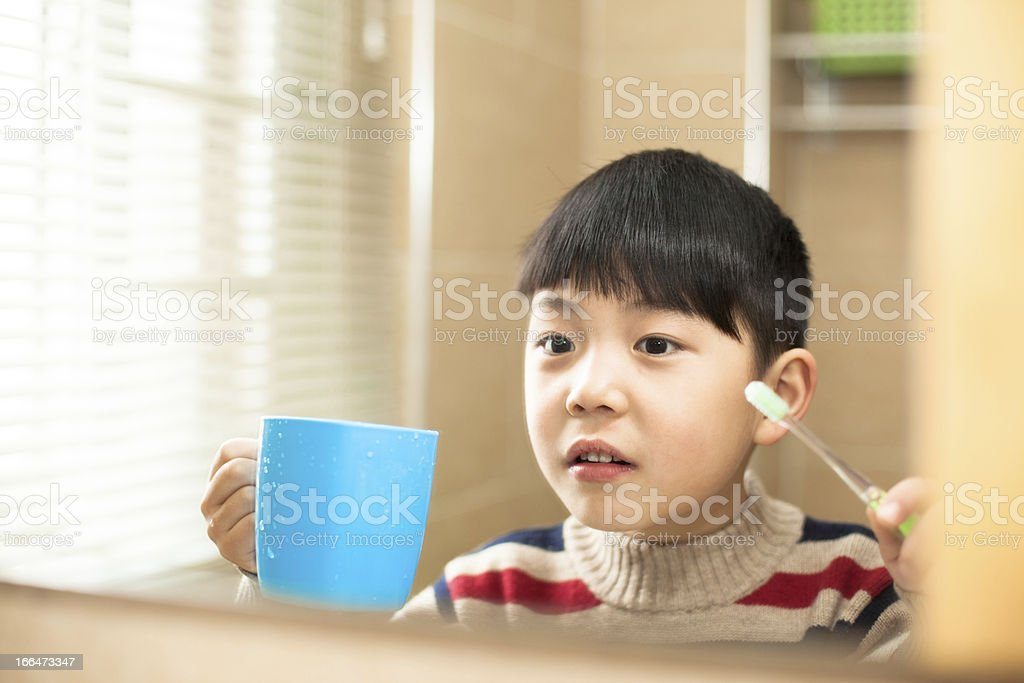Asian boy in the bathroom washing royalty-free stock photo