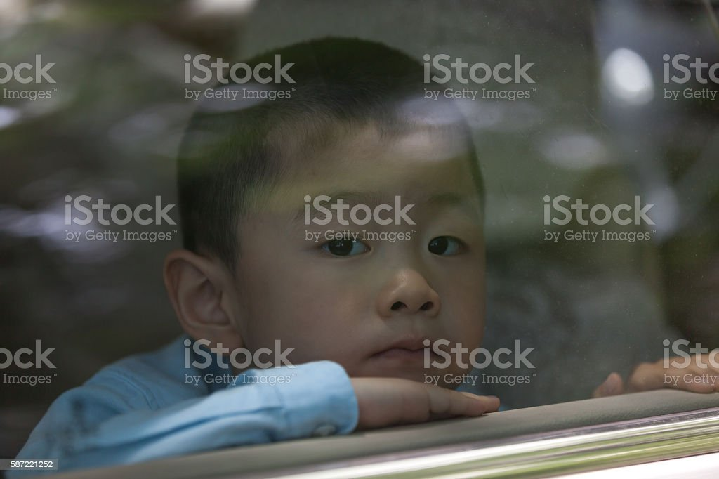 Asian boy jailed in car stock photo