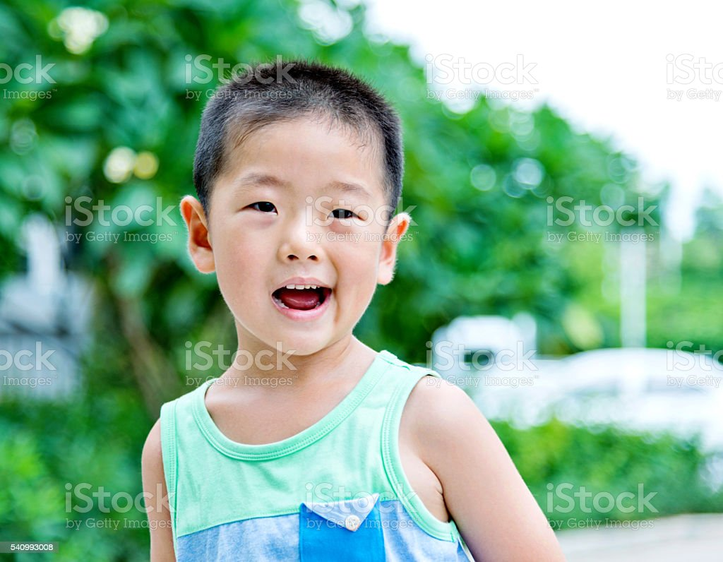 Asian boy laughing stock photo