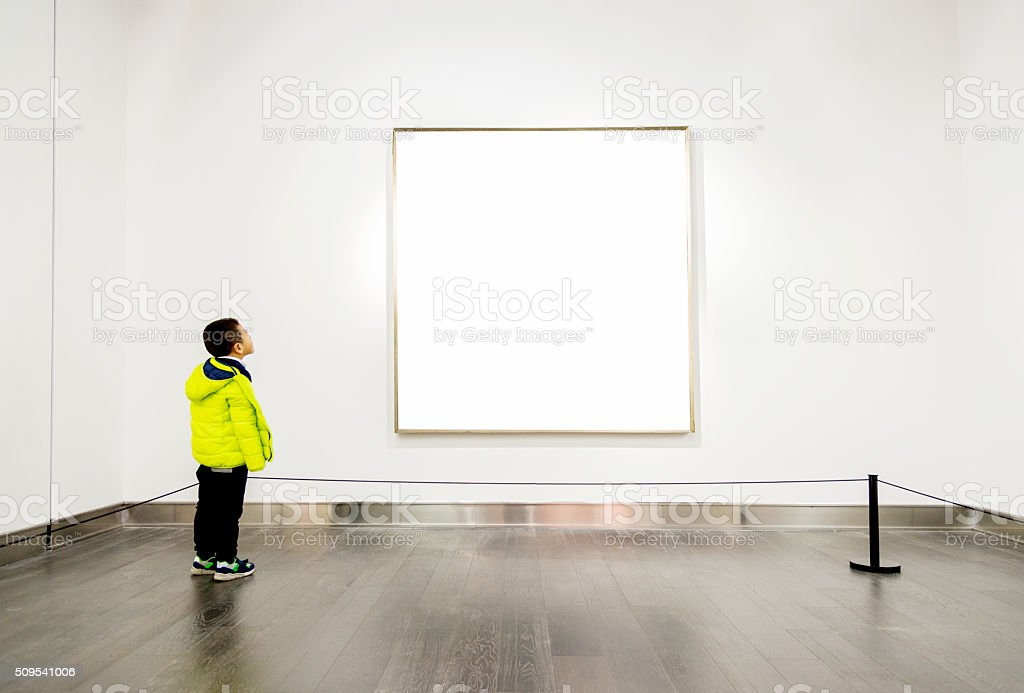 Asian boy looking at artwork stock photo