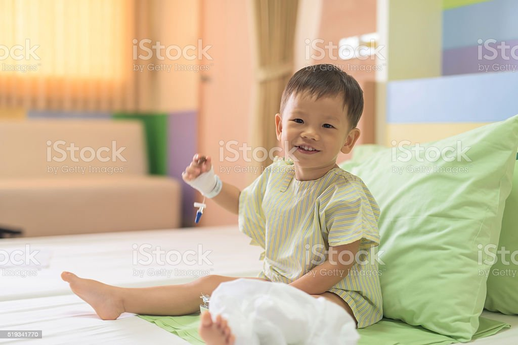 Asian boy on hospital bed stock photo