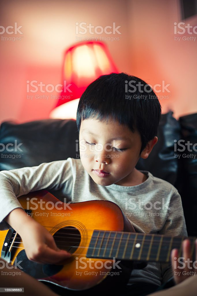 Asian Boy Playing Guitar royalty-free stock photo