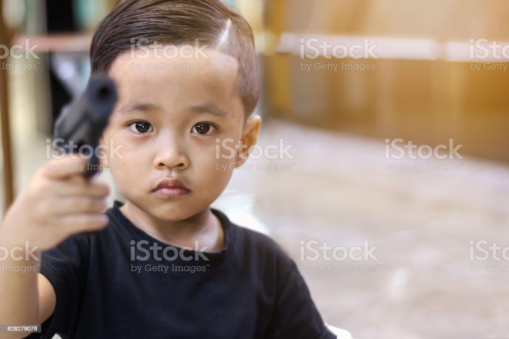 Asian boy playing gun. stock photo