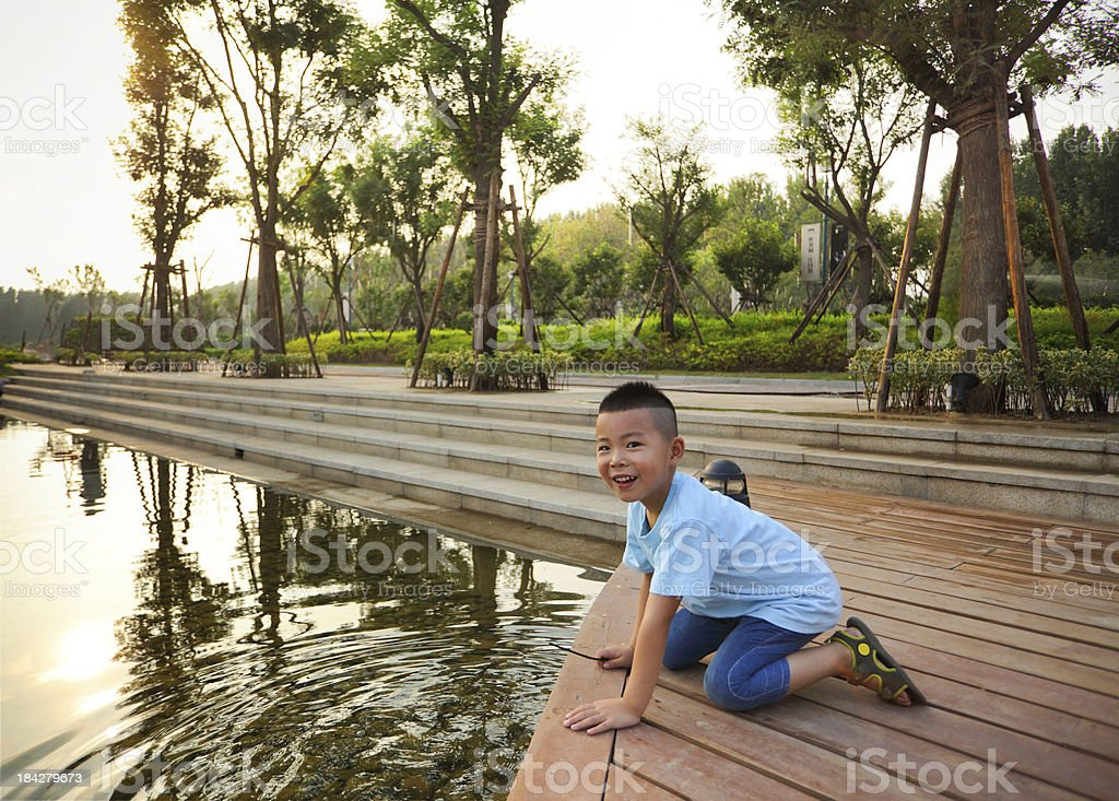 Asian boy playing in the pond stock photo
