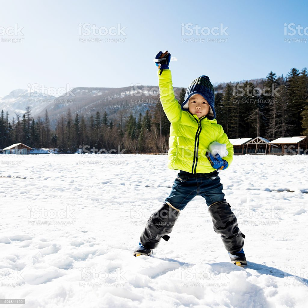 Asian boy playing in the snow stock photo