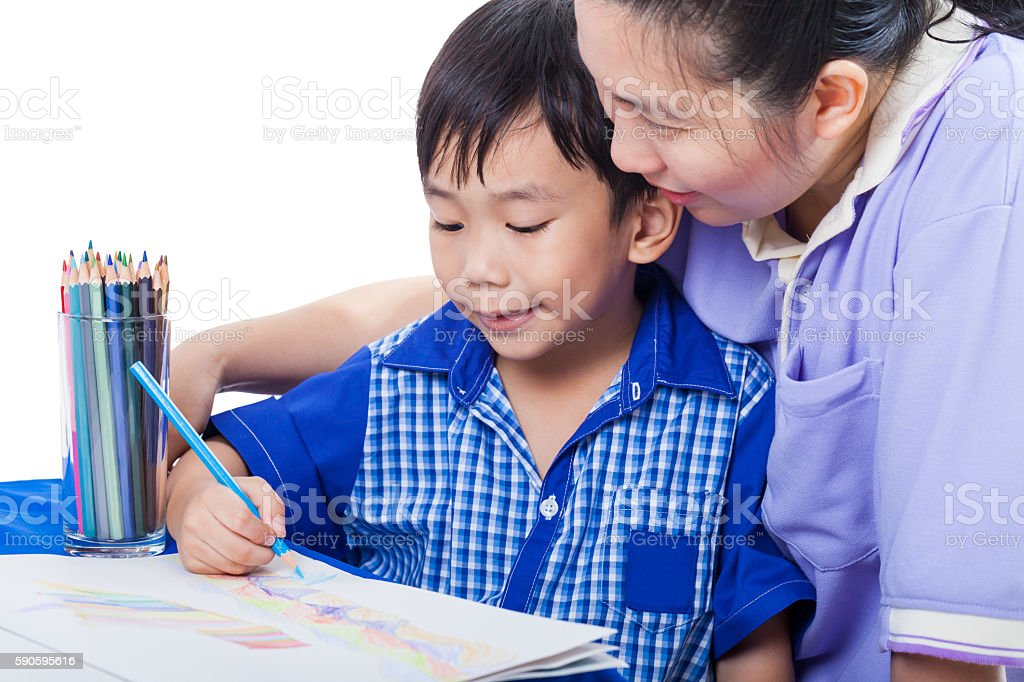 Asian boy sitting and drawing with mother. Education concept. stock photo