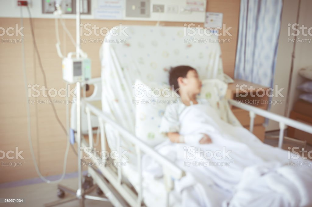Asian boy sleeping with infusion pump intravenous IV drip stock photo