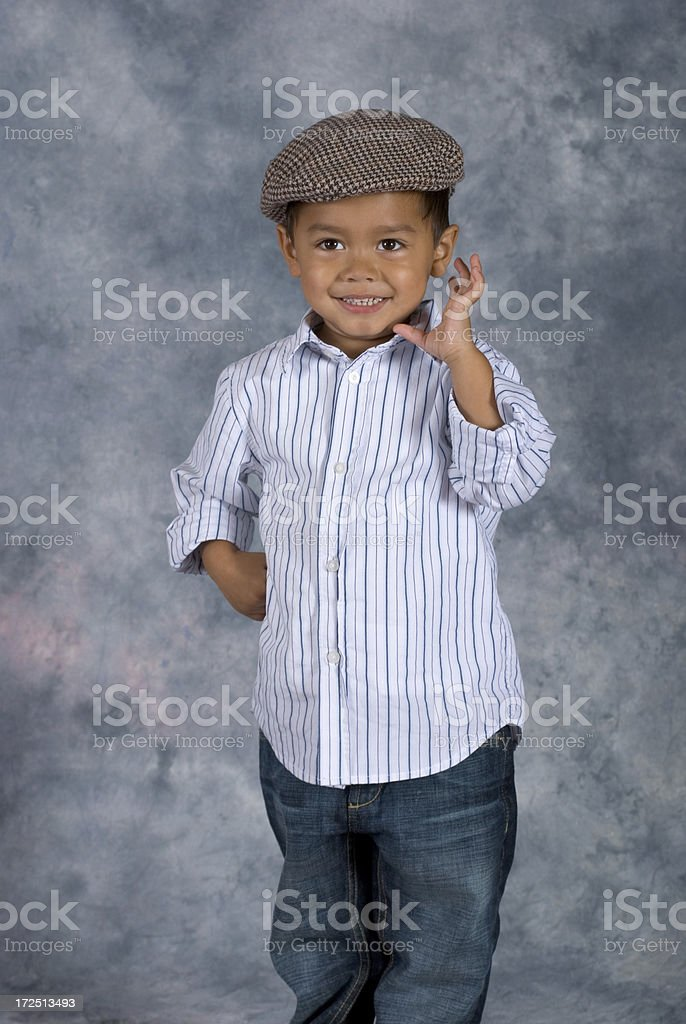 Asian Boy Standing School Pose Hand Near Face royalty-free stock photo