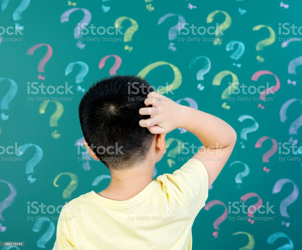 Asian boy thinking for solution stock photo