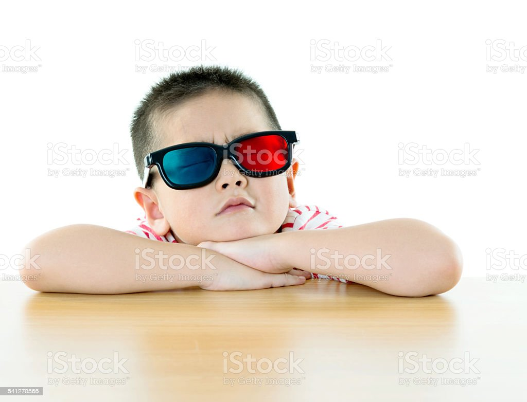 Asian boy with 3D glasses stock photo