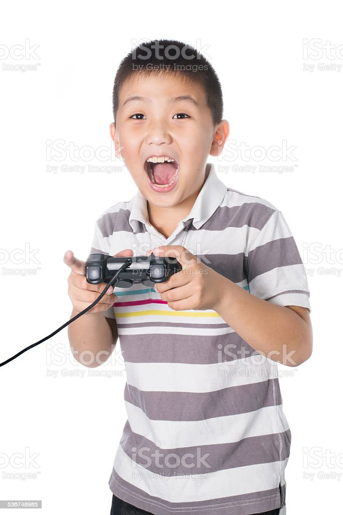 Asian boy with a joystick playing video games, isolated stock photo