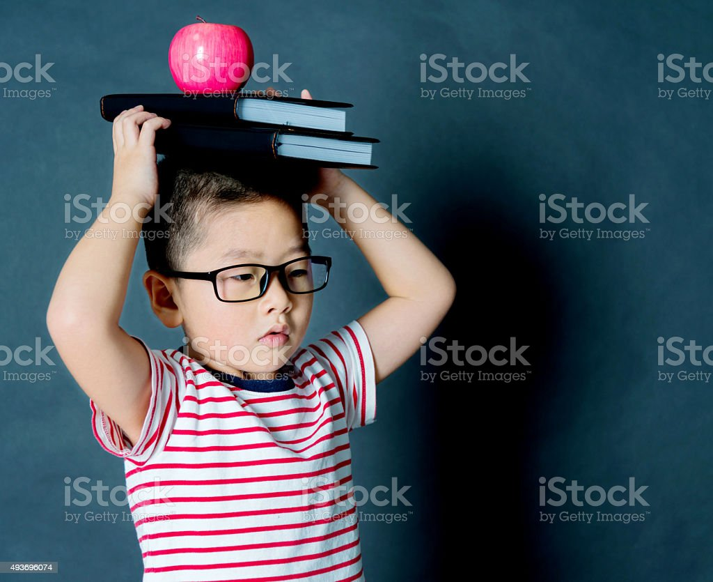 Asian boy with books stock photo