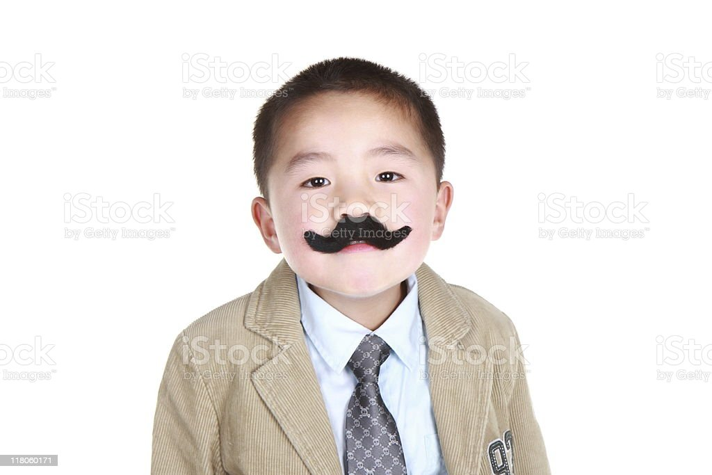 Asian boy with fake mustache and goofy look. stock photo