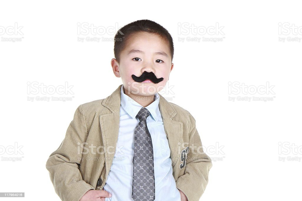Asian boy with fake mustache and sceptical look. stock photo