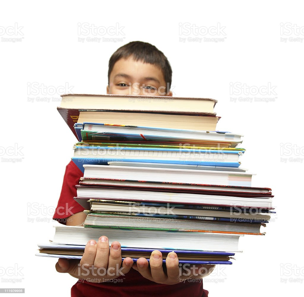 asian boy with stack of books royalty-free stock photo