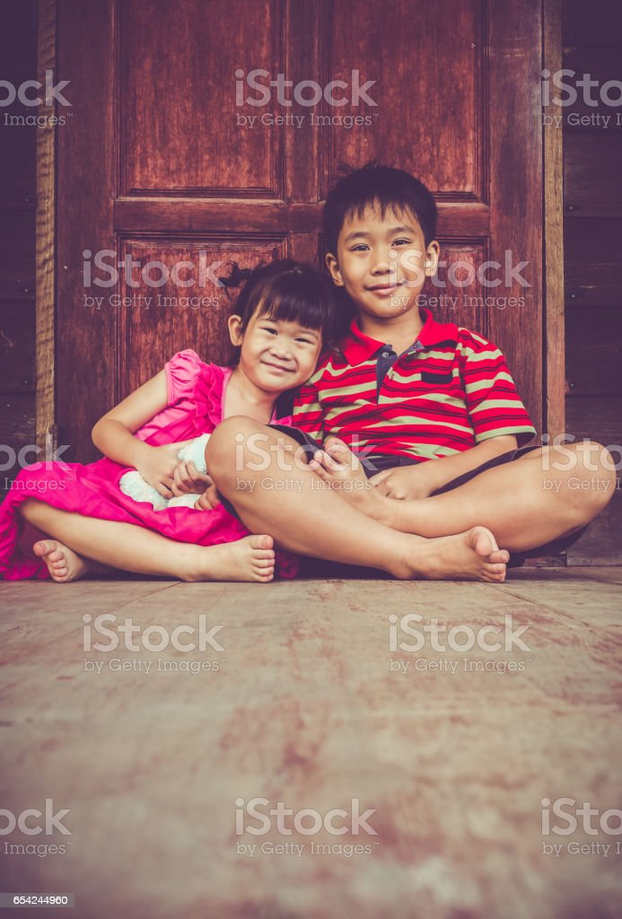 Asian brother with sister smiling happy together. Vintage tone. stock photo