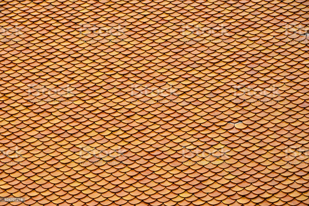 Asian brown ceramic roof tiles texture royalty-free stock photo