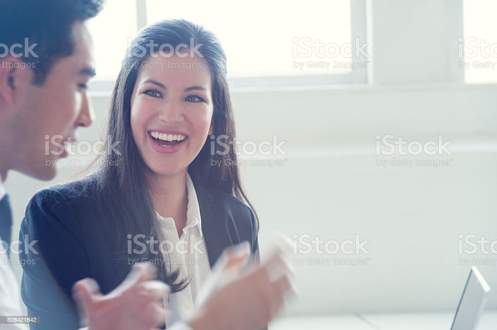 Asian Business colleagues working on laptop. stock photo
