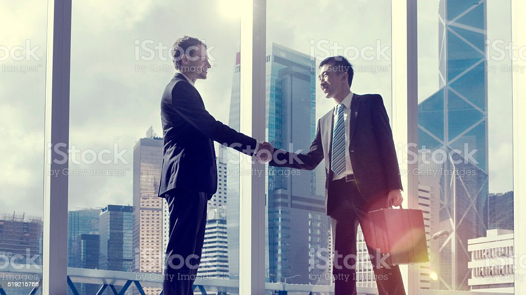 Asian Business Handshake Agreement Partnetship Concept stock photo