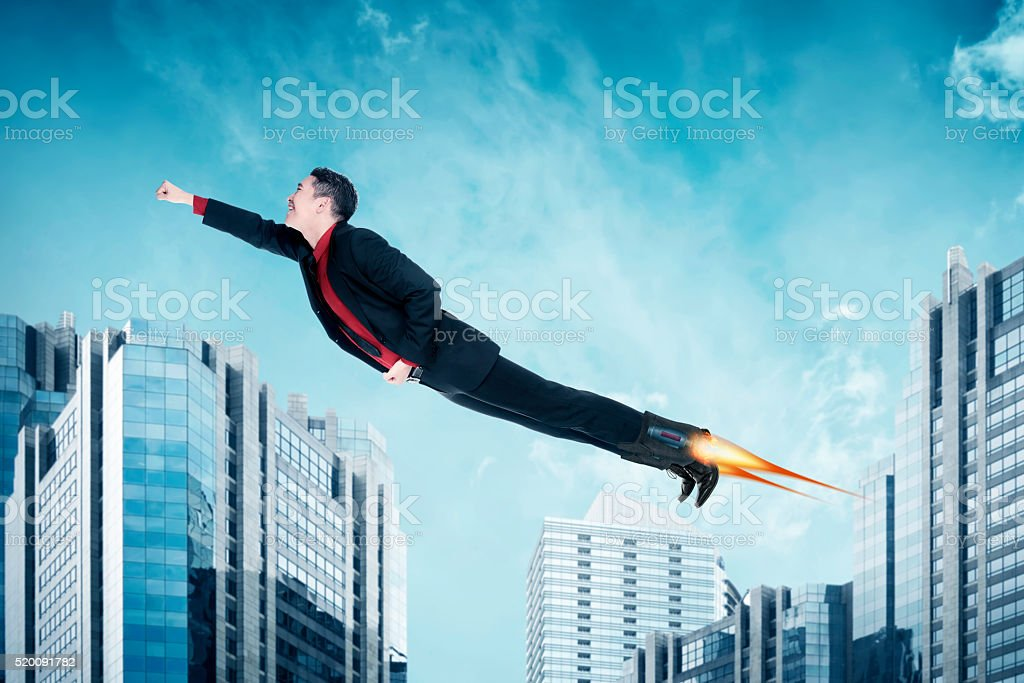 Asian business man flying with rocket on the shoes stock photo