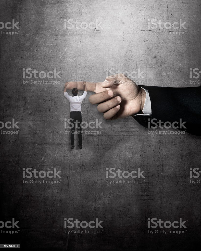 Asian business man hang on large finger stock photo