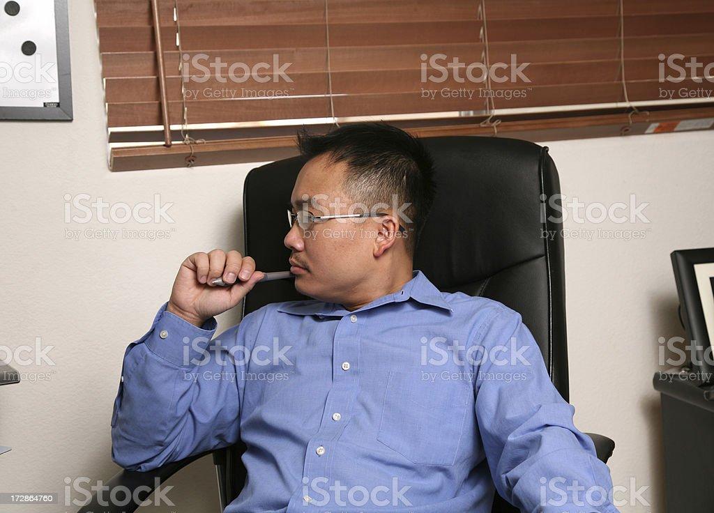 Asian Business man looking at computer screen royalty-free stock photo