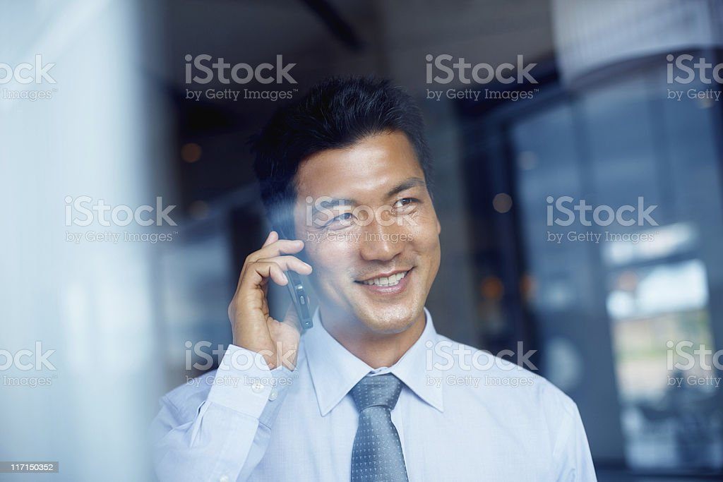 Asian business man on cell phone royalty-free stock photo