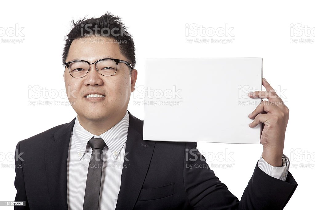Asian business man show a blank sign on his sholder stock photo