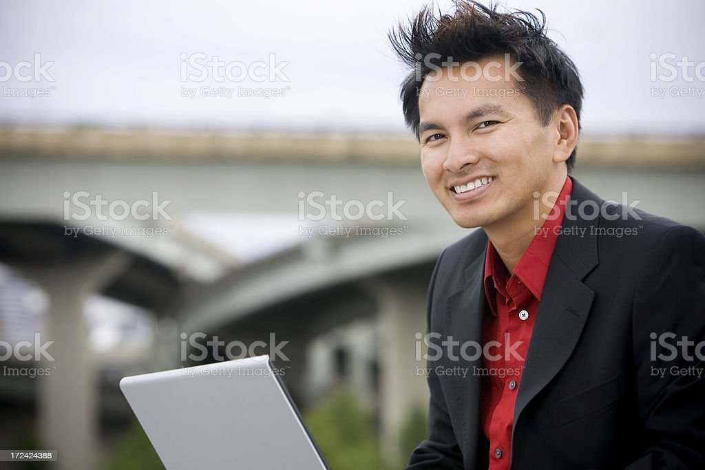 Asian Business Man Smiling, Using Laptop Outdoors, Copy Space stock photo