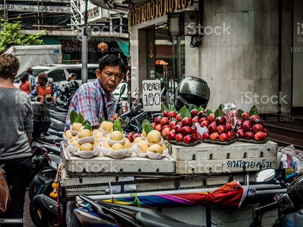Asian Business Man Street Food Vendor, Fruit Stall stock photo