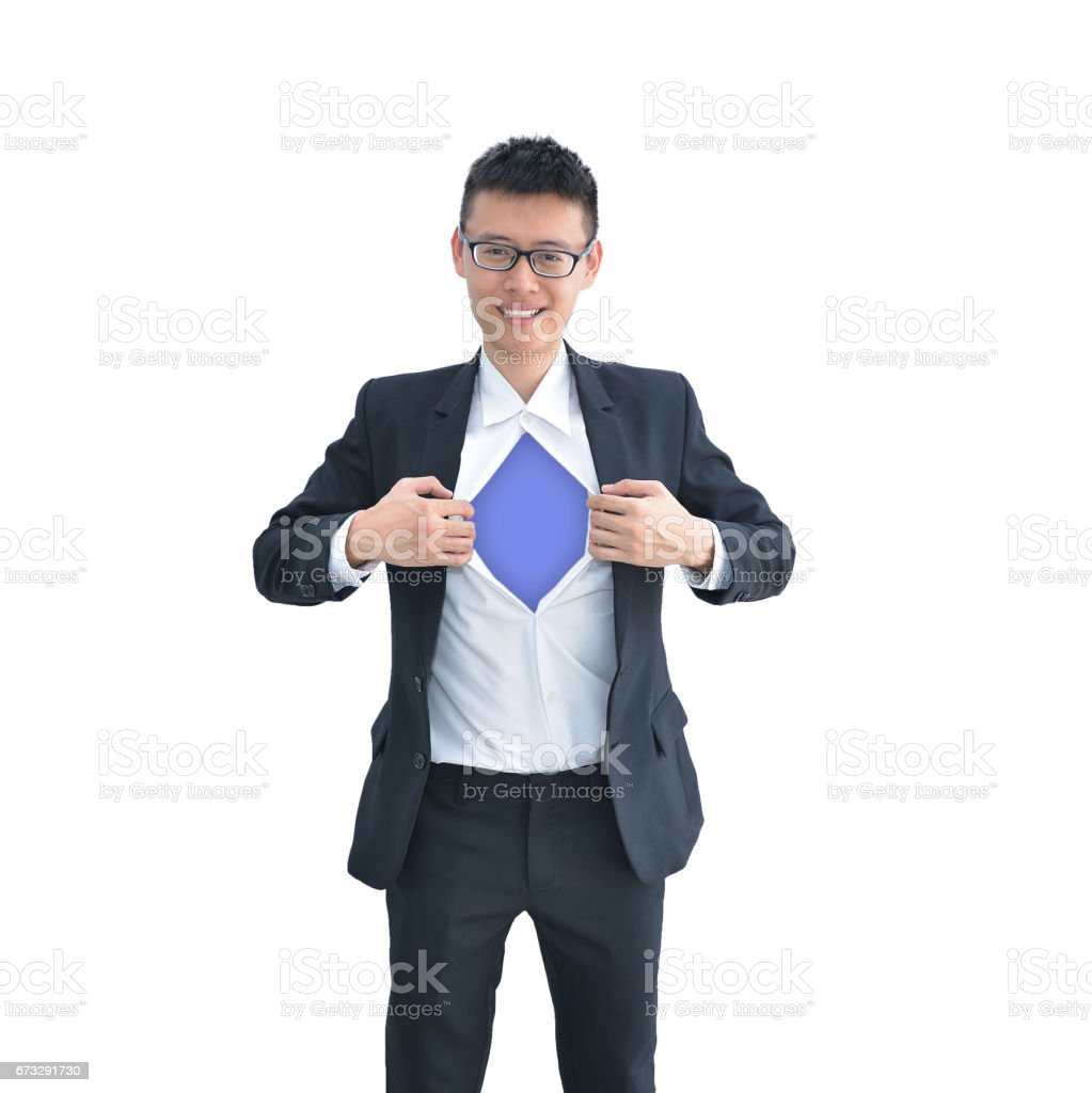 Asian Business man tearing apart his shirt revealing a superhero suit isolated on white background, clipping path inside stock photo