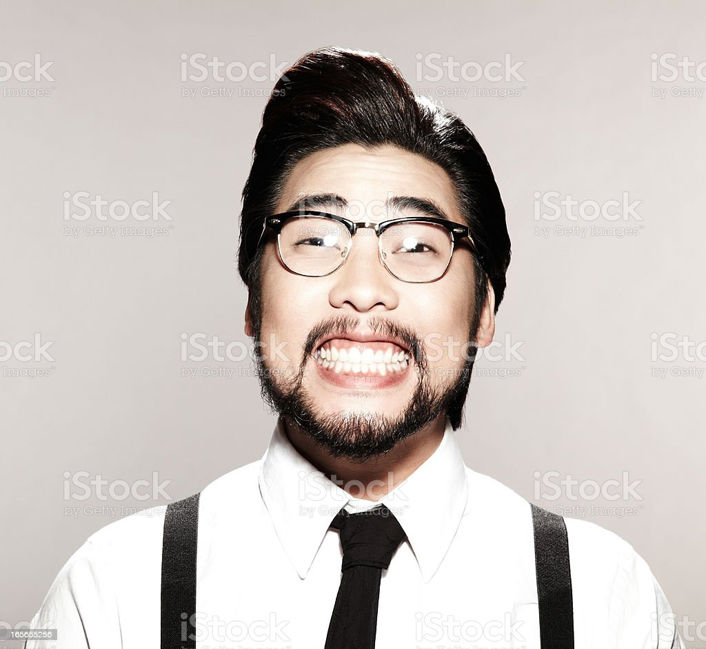 Asian business man with a goofy smile on his face stock photo