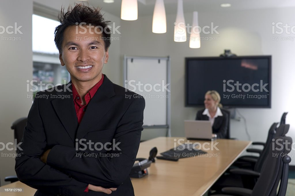 Asian Business Man with Coworker in Meeting Room, Copy Space royalty-free stock photo