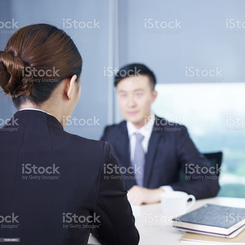 Asian business people having a meeting royalty-free stock photo