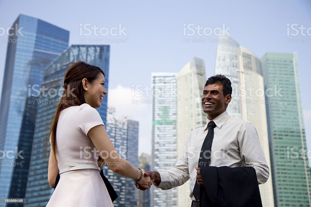 Asian business people meeting with a hand shake. stock photo