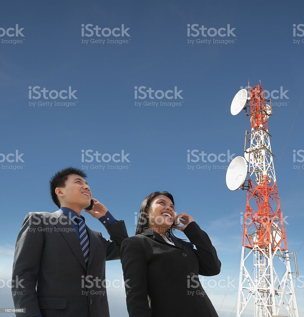 Asian business people on phone and antenna royalty-free stock photo