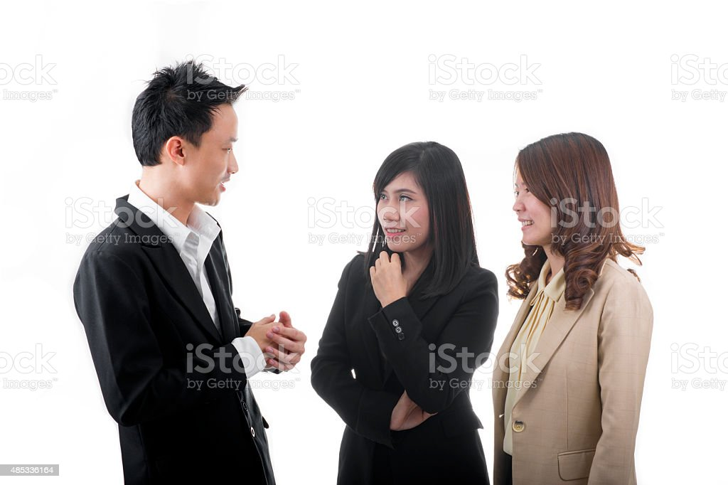 Asian Business People Talking About Assignment royalty-free stock photo