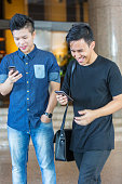 Asian Business People With Their Mobile Phones