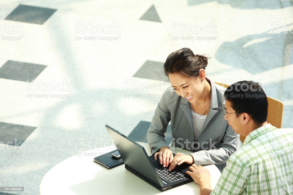 asian business people work on laptop royalty-free stock photo